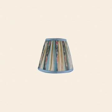 Silk sari ikat lampshade in a very pale celery green, deep near black, and pool blue, with some bits of ruddy red. Lined in pale rosy linen and trimmed with silk shantung.